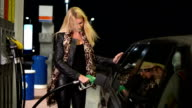 Woman at gas station video