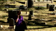 woman at grave video