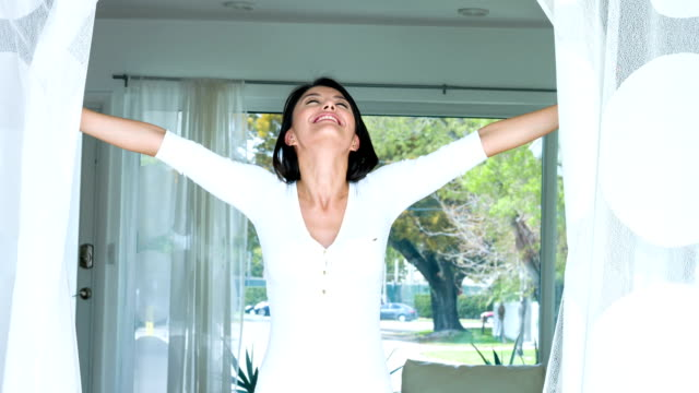 Woman at home enjoying some fresh air video