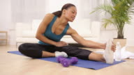 Woman at home stretching and exercising video