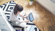Woman at home using a laptop. video