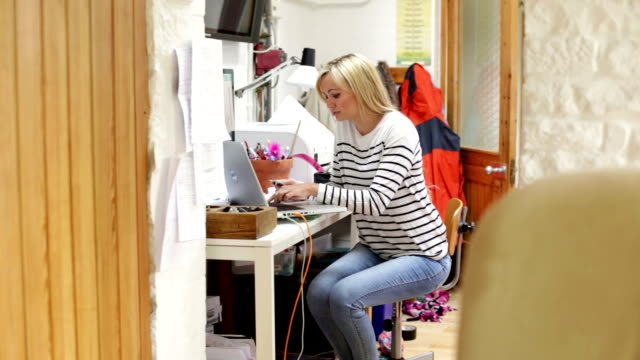 Woman at home using internet banking video