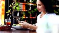 Woman at lunch break sitting in outdoor restaurant bar video