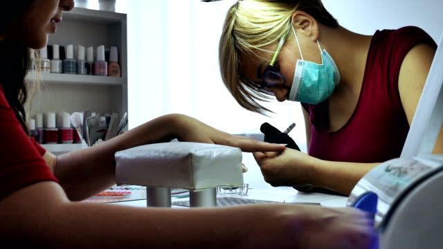 Woman at manicure treatment video