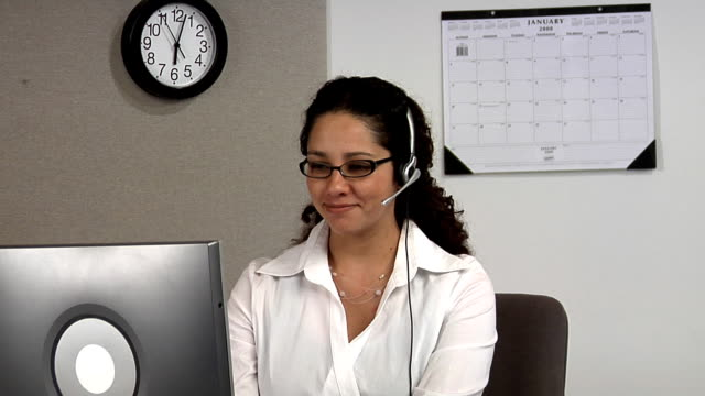 Woman at office desk with headset video