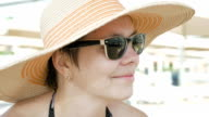 A woman at the beach with fashionable style attire video