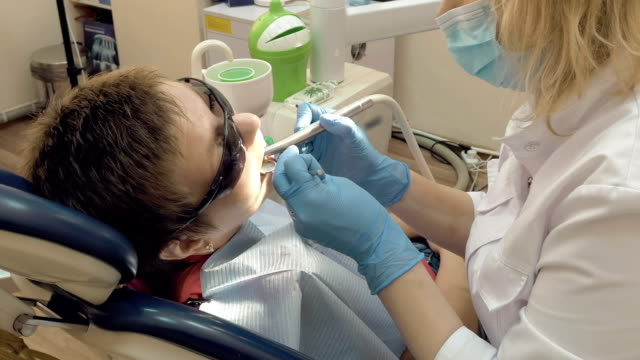 Woman at the dentist medical clinic office video