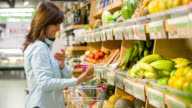 Woman at the supermarket with a shopping list video