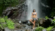 woman at waterfall video