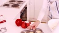 Woman baking muffins video