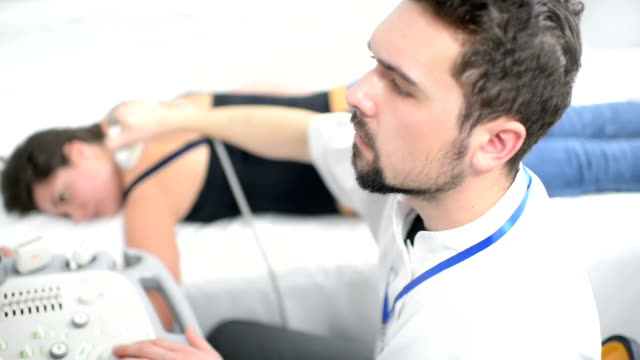 Woman Being Checked at Ultrasound Device video