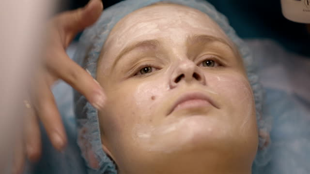 Woman being prepped in a skincare clinic video