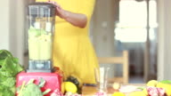 Woman blending pineapple and avocado video