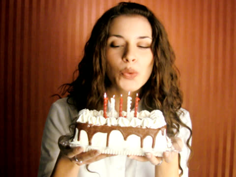 Woman Blowing Birthday Cake candles (PAL Video) video