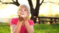 HD SUPER SLOW MO: Woman Blowing Flower Petals video