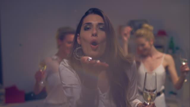 Woman blowing glitter video