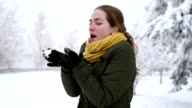 Woman blowing off the snow video
