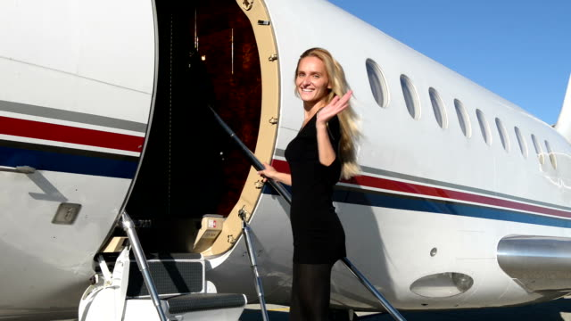 Woman boarding on private jet video