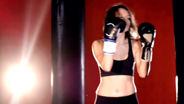 Woman boxing with punching bags. Slow motion. video