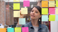 Woman brainstorming at a creative office video