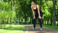 Woman breathing after run marathon outdoor. Tired female runner video