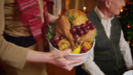 SLO MO woman bringing Christmas turkey to the table video