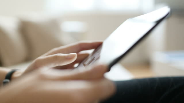 Woman Browsing on Digital Tablet - Hand-held Shot video