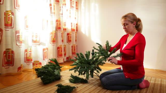 Woman Building Christmas Tree video
