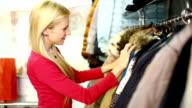 Woman buying clothes. video