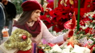 woman buying floral compositions video
