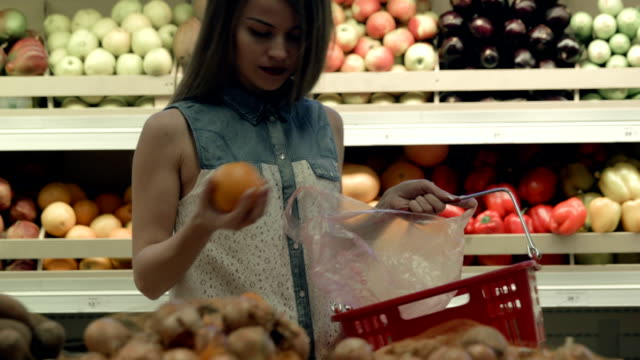 Woman buying groceries in supermarket video