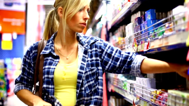 Woman buying in supermarket. video