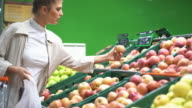 Woman buying some fruit in supermarket. video