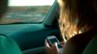 Woman Car Passenger with Smartphone in Hands video