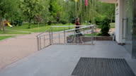 A woman carries a suitcase on a ramp at the hotel. video