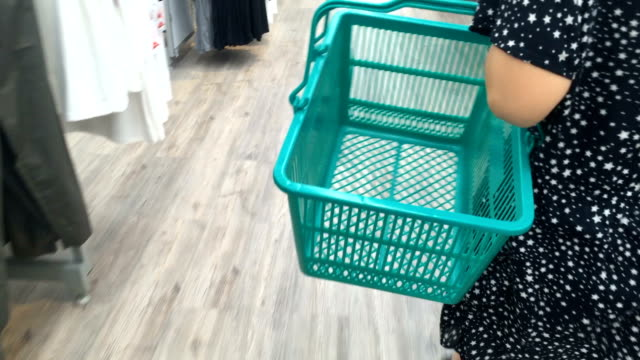 woman carring a basket video
