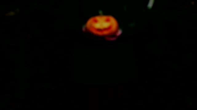Woman carrying on hands terrible pumpkin Jack o Lantern video