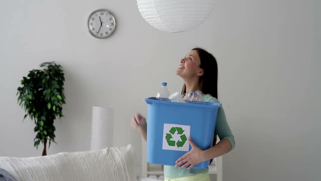 Woman changing light bulbs video