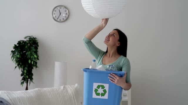 Woman changing light bulbs video