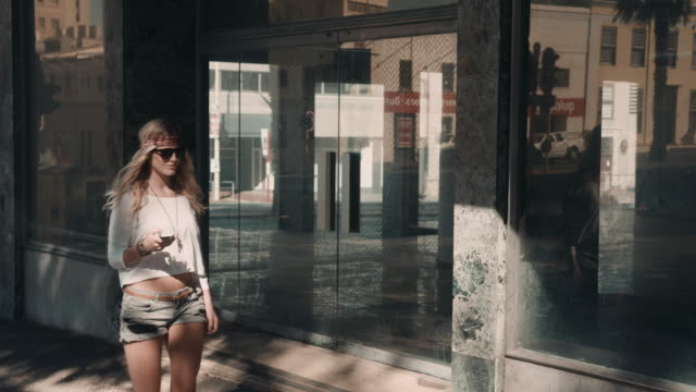 Woman checking phone in urban setting video