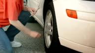woman Checking Tire Air video