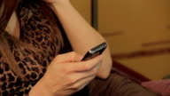 Woman checking updates old mobile phone, relationship, flirting video