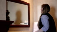 Woman checks out herself in luxurious hotel bathroom video