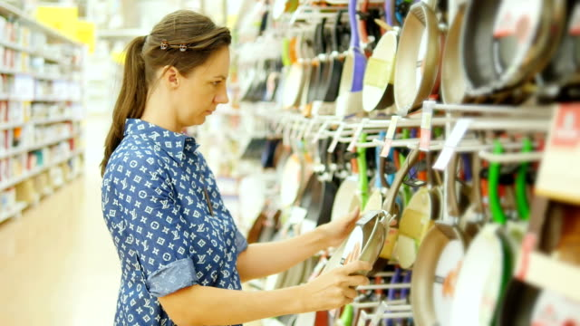woman chooses a dish in the supermarket video