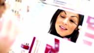 Woman choosing a mascara at beauty store. video
