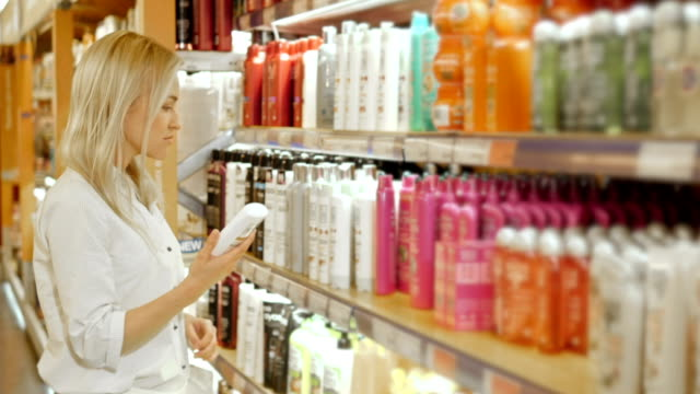 Woman Choosing Body Care Products In Supermarket video
