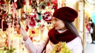 woman choosing Christmas decoration video