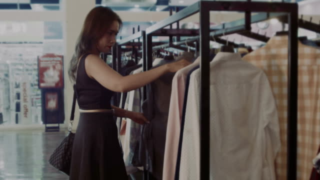 Woman choosing clothes in the mall video