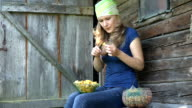 woman clean carefully forest chanterelle outdoor in country. video