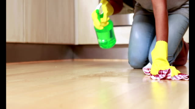Woman cleaning her kitchen floor video